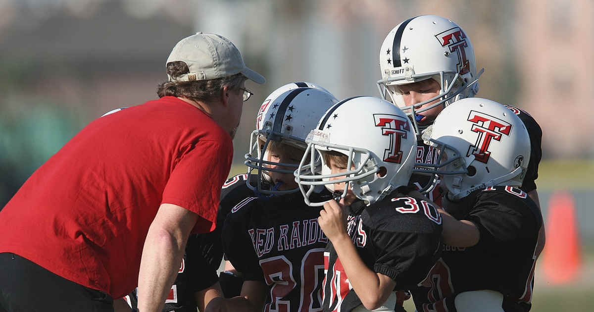 Coach nella fase di formazione di una squadra di football americano